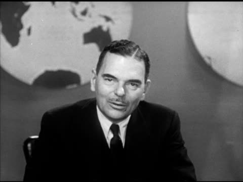 Governor of New York Thomas E Dewey sitting behind desk SOT talking about nonCommunist Chinese people throughout Southeast Asia if they become...