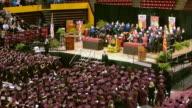 WS ASU graduation ceremony diginitairies on elevated dais and graduating students / Phoenix, Arizon, USA
