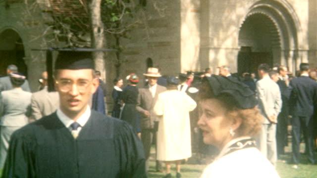 Graduation Photo Poses / Shove Memorial Chapel / Beta Omega Pi / Happy Graduate and Girlfriend / Colorado College Graduation on June 12 1955 in...