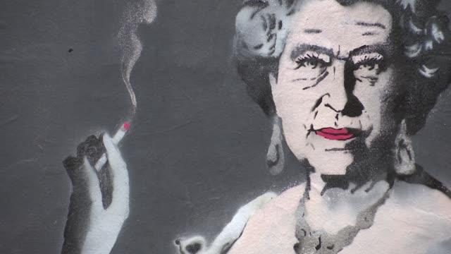 Graffiti art of the Queen by street artist Loretto ENGLAND London Northington Street EXT Various of graffiti art paintings of Queen Elizabeth II...