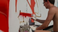 Graffiti artist spraying paint on wall (HD)