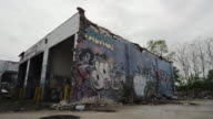 Graffitti on exterior of abandoned building in Detroit