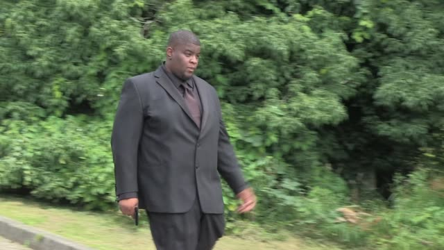 Grammy winning producer Salaam Remi leaves on foot from Edgwarebury Cemetery after so many friends and relatives attended Amy Winehouse's funeral...
