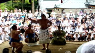 A grand champion of Japan's sumo wrestling on Wednesday August 26 showed a ceremonial performance at an old shrine in Yahiko village in Niigata...