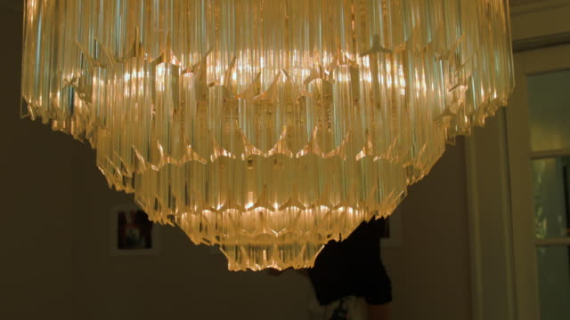 A grand crystal chandelier hanging in the former home of Al Capone
