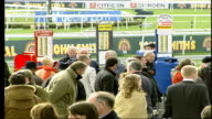 Grand National 2006 ENGLAND Liverpool Aintree race course EXT Spectators in stands TILT Punter taking betting ticket from tote Course bookmakers...