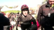 Grand National 2015 won by Many Clouds ENGLAND Liverpool Aintree Racecourse EXT High Angle GVs of punters and stands at racecourse Horse and jockey...