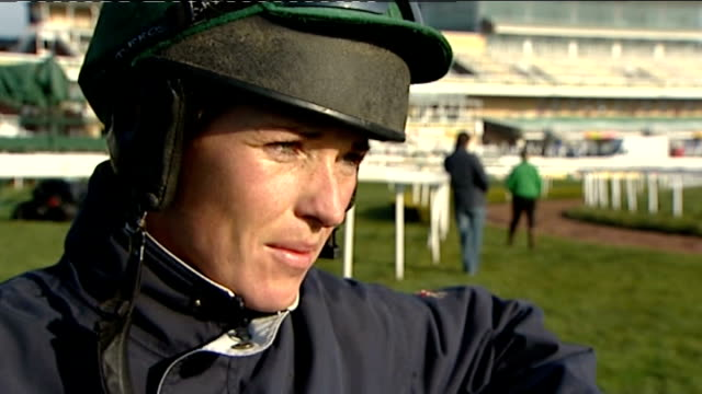 Grand National preview Katie Walsh interview / general views of horses ENGLAND Merseyside Liverpool Aintree racecourse EXT Female spectator wearing...