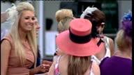 Grand National preview women jockeys ENGLAND Merseyside Aintree EXT Women racegoers wearing exotic hats at Aintree Ladies' Day Close shot of woman's...