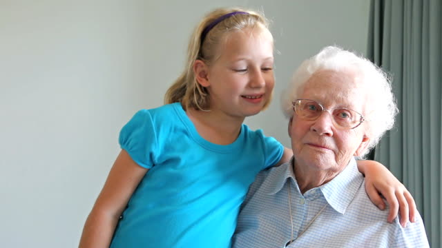 Grandaughter with arm around her Grandmother