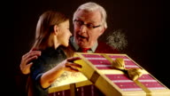 Grandfather and grandchild opening Christmas gift
