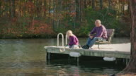 Grandfather and Granddaughter Fishing in Nature - MS