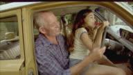 MS, Grandfather and granddaughter (10-11) pretending to drive car, Tamborine Mountain, Brisbane, Queensland, Australia