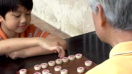 Grandfather and Grandson Chinese Chess Slow Motion