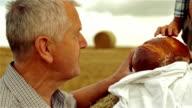 Grandfather, grandson and bread.