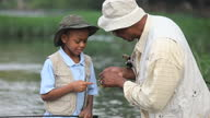 MS TU Grandfather teaching grandson (8-9) about fly fishing / Richmond, Virginia, USA