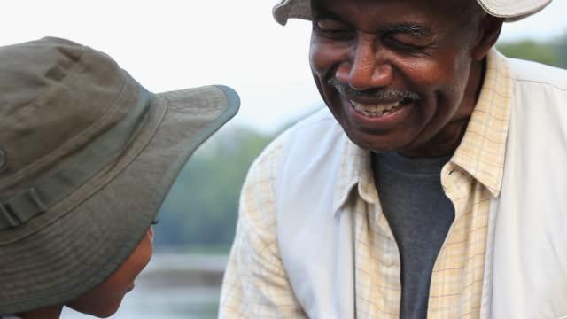 CU TU Grandfather teaching grandson (8-9) about fly fishing / Richmond, Virginia, USA