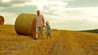 grandfather with his grandson in the field