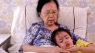 Grandma comforting her crying granddaughter