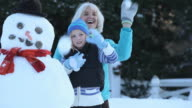 MS PAN Grandmother and grandchildren (4-9) having snowball fight / Richmond, Virginia, USA
