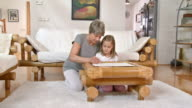 HD DOLLY: Grandmother Helping Her Granddaughter To Draw
