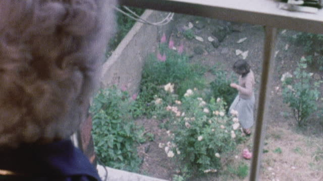 1978 HA Grandmother looking through the window while recalling how she started smoking / United Kingdom