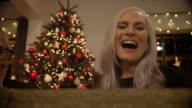 Grandmother opening christmas present