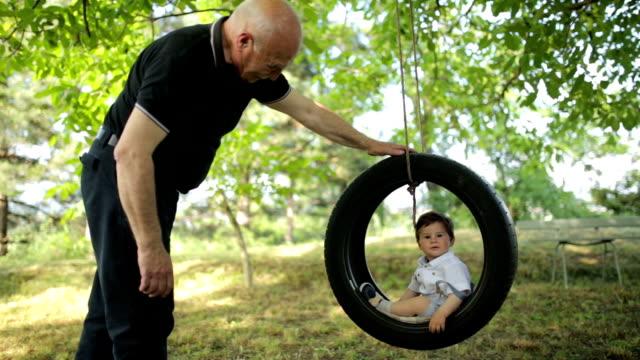 Grandpa and toddler having fun
