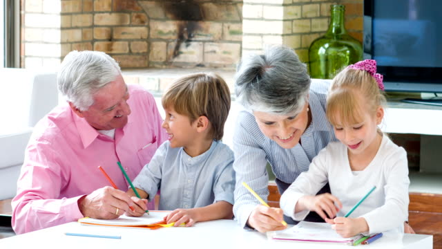 Grandparents babysitting grandchildren at home