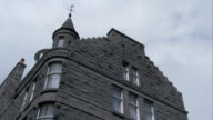 Granite tenements characterize a neighborhood in Aberdeen, Scotland. Available in HD.