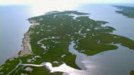 A grassy peninsula reaches out into the ocean along the Gulf Islands National Seashore in Mississippi.