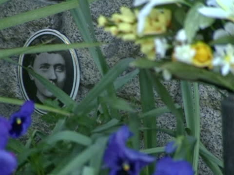 / grave site of Hitler's parents Alois and Klara at the cemetery in the village of Leonding outside Linz / CU portrait of Klara Hitler / the...