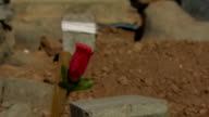 Graves of Peshmerga fighters killed by Islamic State militants in Iraq