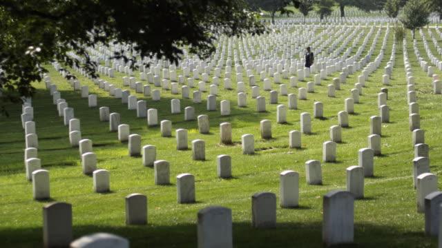 MS Gravestones at Arlington National Cemetery, Section 33, woman in background, Arlington, Virginia, USA