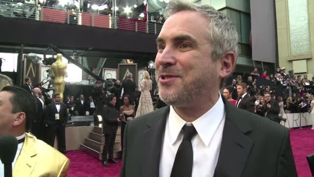 Gravity director Alfonso Cuaron praised the work of his team which won an Oscar for visual effects CLEAN Gravity director praises visual effects te...