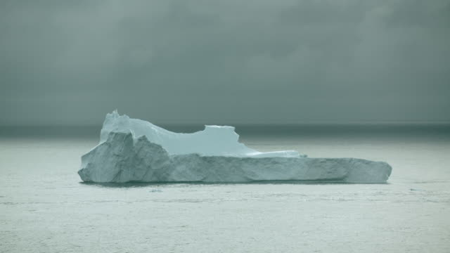 Gray Clouds Over Arctic Iceberg