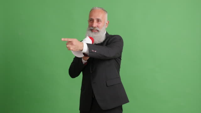 gray-haired businessman holding a presentation with a megaphone
