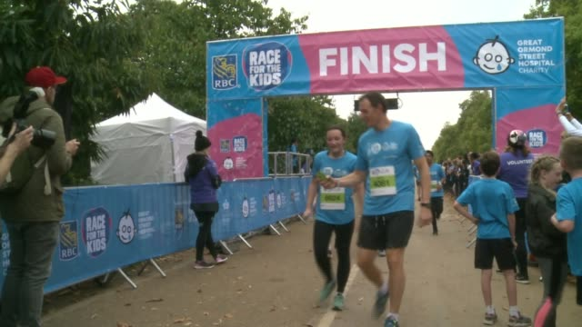 Great Ormond Street Hospital charity run ENGLAND London Hyde Park EXT Runners crossing finish line for 'Race for the Kids'