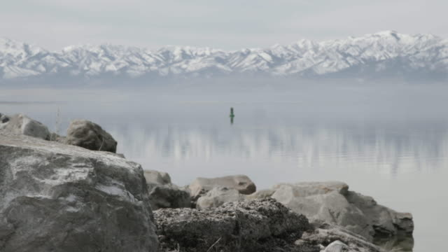 Great Salt Lake with mountains in background, foggy