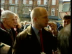 William Hague MP standing with supporters and eating a chip MS Sebastian Coe eating chips standing with others MS Hague chatting man
