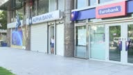 Greece announces it will shut banks for a week and imposes capital controls pleading for calm after anxious citizens emptied cash machines in a...