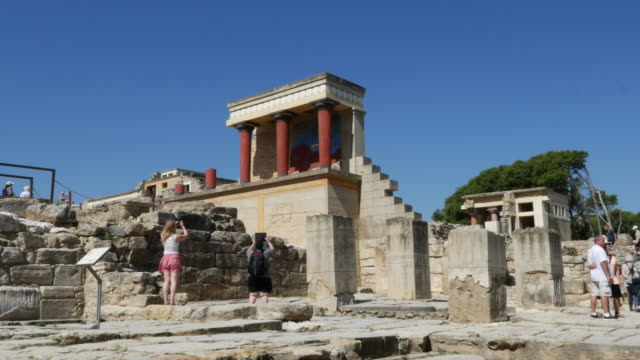 Greece Crete Knossos Minoan Civilization restoration with touring couple