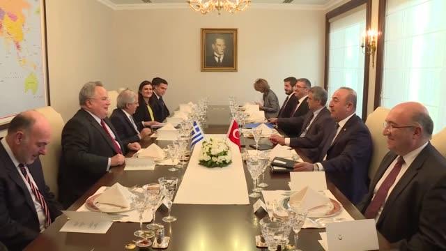 Greek Foreign Minister Nikos Kotzias meets with Turkish Foreign Minister Mevlut Cavusoglu in Ankara Turkey on October 24 2017