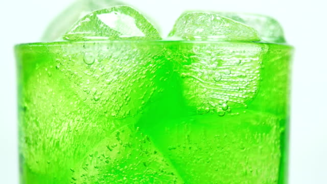 green apple soft drink splashing close-up 4k resolution