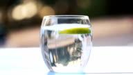 Green Apples Splashing Into Water