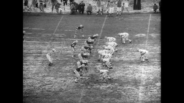 Green Bay Packers meet the Cleveland Browns at Labeau Field for the NFL Championship game / crowd pack a snowy stadium and workers try to clean the...