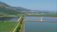 AERIAL Green fields and reservoirs in Hula valley / Upper Galilee, Israel