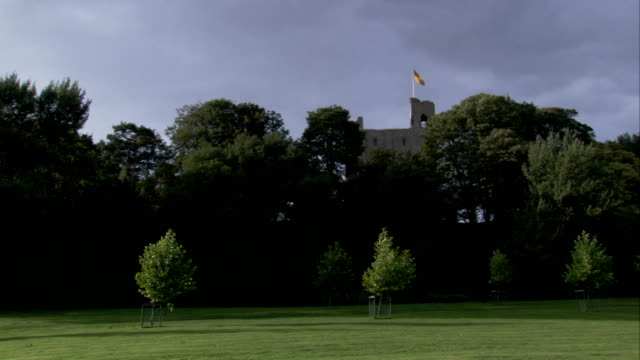 Green lawns and trees surround Hedingham Castle in Essex. Available in HD.