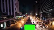 4K : Green screen billboard at night