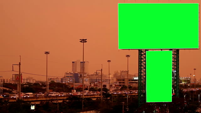 Green screen billboard with traffic at night